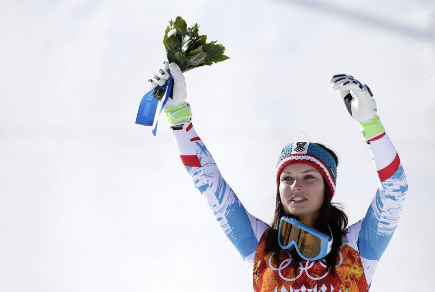 Women's super-G gold medal winner Anna Fenninger of Austria waves from the podium at the Sochi 2014 Winter Olympics, Saturday, Feb. 15, 2014, in Krasnaya Polyana, Russia. (AP Photo/Gero Breloer)