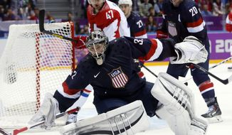 USA goaltender Jonathan Quick comes out of the crease to defend the goal in the third period of a men's ice hockey game at the 2014 Winter Olympics, Saturday, Feb. 15, 2014, in Sochi, Russia. (AP Photo/Mark Humphrey)