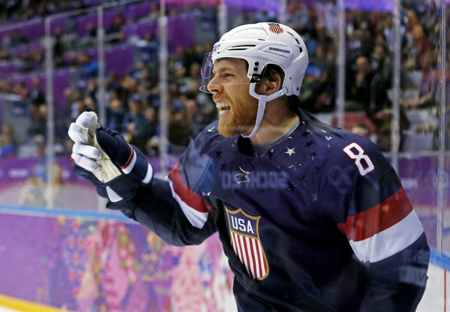 USA forward Joe Pavelski reacts after scoring a second period goal against Russia during a men's ice hockey game at the 2014 Winter Olympics, Saturday, Feb. 15, 2014, in Sochi, Russia. (AP Photo/Julio Cortez)