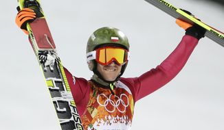 Poland's Kamil Stoch celebrates winning the gold during the ski jumping large hill final at the 2014 Winter Olympics, Saturday, Feb. 15, 2014, in Krasnaya Polyana, Russia. (AP Photo/Gregorio Borgia)