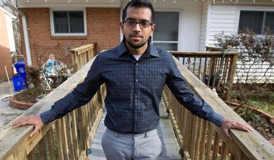"Yves Gomes, a student at the University of Maryland, who's parents were deported, poses for a photo outside his great uncle's house where he lives in Silver Spring, Md., Friday Jan. 17,  2014. Gomes says he considers himself one of the lucky ones _ lucky, at least, among the so-called ""dreamers."" Even though his parents were deported and his legal status was once in limbo, today the 21-year-old Indian native attends the University of Maryland paying in-state tuition.  ( AP Photo/Jose Luis Magana)"