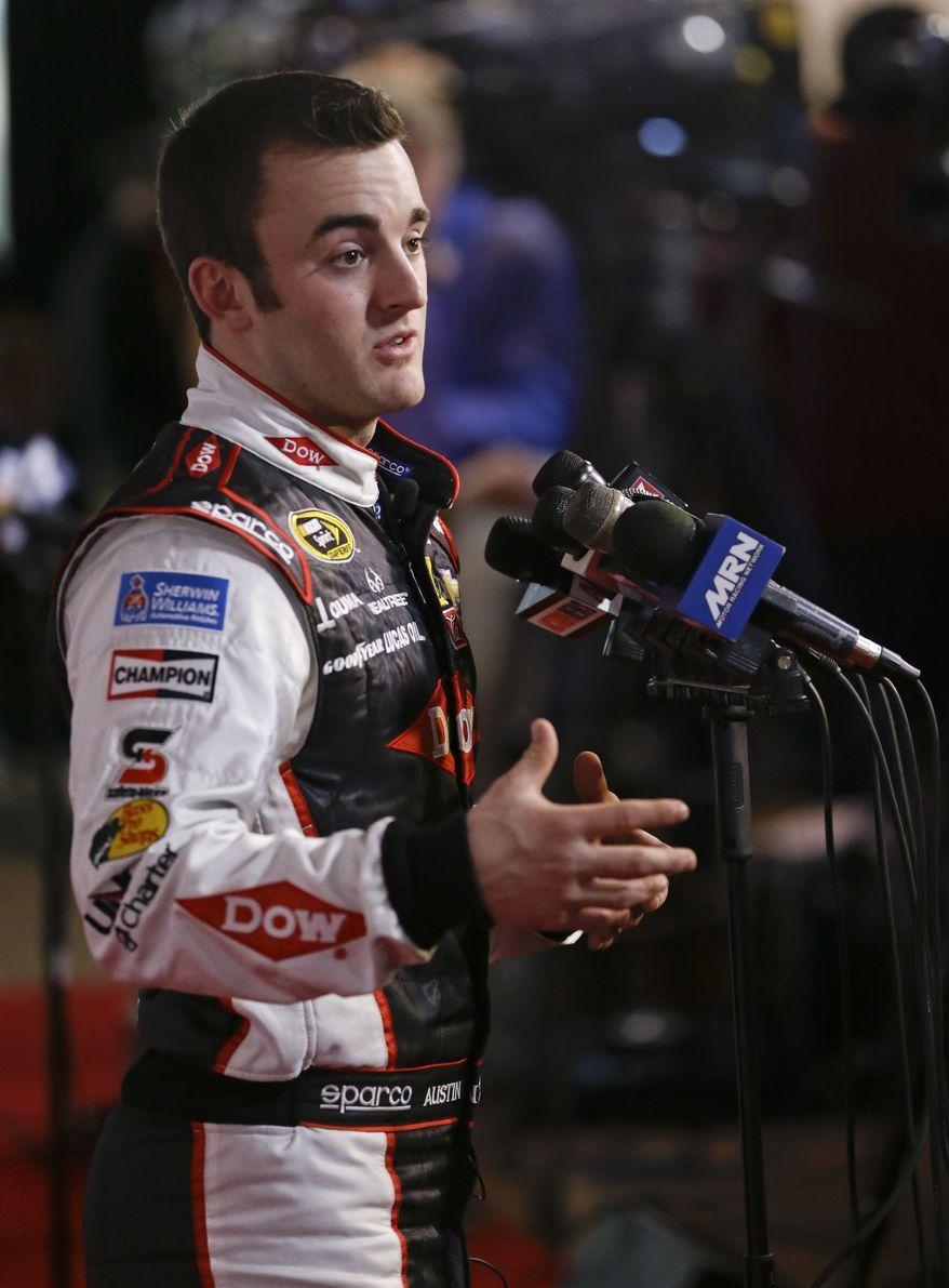 Driver Austin Dillon answers reporters questions during NASCAR auto racing media day at Daytona International Speedway in Daytona Beach, Fla., Thursday, Feb. 13, 2014. (AP Photo/John Raoux)