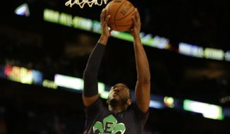 East Team John Wall, of the Washington Wizards (2) drives to the hoop as West Team's Damian Lillard, of the Portland Trail Blazers (0) looks on during the NBA All Star basketball game, Sunday, Feb. 16, 2014, in New Orleans. (AP Photo/Gerald Herbert)