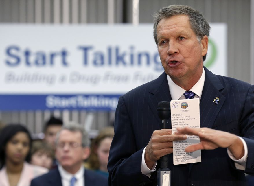 FILE - In this Jan. 8, 2014 file photo, Ohio Gov. John Kasich speaks about a new drug abuse prevention initiative being started for the state at West Carrollton Middle School in West Carrollton, Ohio. Kasich seemed at first to relish the idea he'd be a one-term governor, having presumably alienated partisans, lobbyists, unions and voters as he made painful but necessary changes to government operations. More recently, the 61-year-old Republican has taken on a more conciliatory, politically moderate approach that observers say could be intended to position him for re-election in his perennially purple state or for a repeat run for president. (AP Photo/Al Behrman, File)