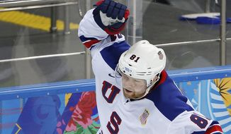 USA forward Phil Kessel celebrates his goal against Slovenia during the 2014 Winter Olympics men's ice hockey game at Shayba Arena Sunday, Feb. 16, 2014, in Sochi, Russia. (AP Photo/Petr David Josek)