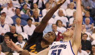 Saint Louis forward Rob Loe (51) battles for a rebound against VCU guard Treveon Graham during the first half of an NCAA college basketball game on Saturday, Feb. 15, 2014, at Chaifetz Arena in St. Louis. Saint Louis beat VCU 64-62.(AP Photo/St. Louis Post-Dispatch, Chris Lee)  EDWARDSVILLE INTELLIGENCER OUT; THE ALTON TELEGRAPH OUT