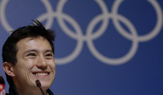 Silver medalist figure skater Patrick Chan, of Canada, speaks at a news conference at the 2014 Winter Olympics, Saturday, Feb. 15, 2014, in Sochi, Russia. (AP Photo/Morry Gash)