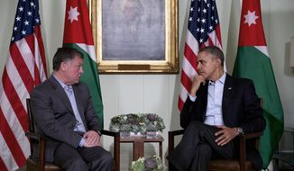 President Barack Obama, right, meets with Jordan's King Abdullah II at The Annenberg Retreat at Sunnylands, Rancho Mirage, Calif., Friday, Feb. 14, 2014. (AP Photo/Jacquelyn Martin)