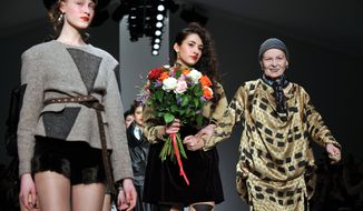 Dame Vivienne Westwood, right,  at the Vivienne Westwood presentation during London Fashion Week Autumn/ Winter 2014 on Sunday, Feb. 16, 2014 at Somerset House in London. (Photo by Richard Chambury/Invision/AP Images)