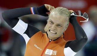 Silver medalist Koen Verweij of the Netherlands grabs his hair when the race was declared a tie with gold medalist Poland's Zbigniew Brodka  in the men's 1,500-meter speedskating race at the Adler Arena Skating Center during the 2014 Winter Olympics in Sochi, Russia, Saturday, Feb. 15, 2014. Verweij later was later declared silver, losing by three thousandth of a second. (AP Photo/Patrick Semansky)