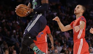 East Team's Kyrie Irving, of the Cleveland Cavaliers (2) goes to the hoop against the West Team during the NBA All Star basketball game, Sunday, Feb. 16, 2014, in New Orleans. (AP Photo/Gerald Herbert)