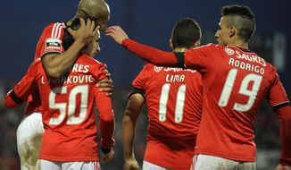 Benfica's Lazar Markovic, from Serbia, celebrates with Luisao, left, from Brazil, Rodrigo Lima from Brazil, and Rodrigo Machado, right, from Spain, after scoring his side's second goal against Pacos Ferreira in a Portuguese League soccer match at Mata Real stadium in Pacos de Ferreira, northern Portugal, Sunday, Feb. 16, 2014. Lazar Markovic scored once in Benfica's 2-0 victory.(AP Photo/Paulo Duarte)