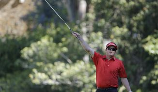 Charlie Beljan signals to his right after his tee shot the 12th hole during the second round of the Northern Trust Open golf tournament at Riviera Country Club in the Pacific Palisades area of Los Angeles, Friday, Feb. 14, 2014.  (AP Photo/Reed Saxon)
