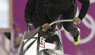 The team from the United States USA-1, piloted by Elana Meyers, start a run during a women's bobsleigh training session at the 2014 Winter Olympics, Saturday, Feb. 15, 2014, in Krasnaya Polyana, Russia. (AP Photo/Dita Alangkara)