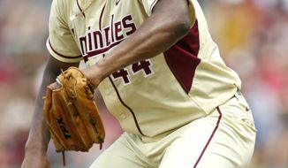 FILE- In this June 9, 2013, file photo, Florida State pitcher Jameis Winston (44) throws in the seventh inning of an NCAA college baseballtournamentsuper regionalgame against Indiana in Tallahassee, Fla. Winston will become the sixth Heisman winner to play college baseball after winning the award and the first since Bo Jackson in 1986. Winston is the Seminoles' closer, will DH and play outfield. (AP Photo/Phil Sears, File)