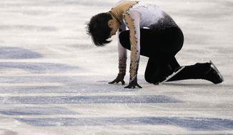 Yuzuru Hanyu of Japan competes in the men's free skate figure skating final at the Iceberg Skating Palace during the 2014 Winter Olympics, Friday, Feb. 14, 2014, in Sochi, Russia. (AP Photo/Darron Cummings)