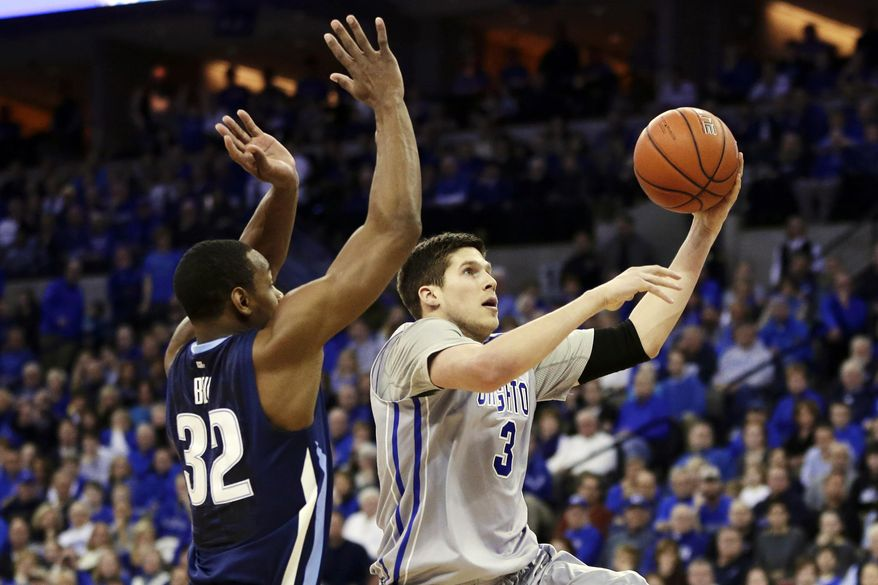 Creighton's Doug McDermott (3) goes for a layup against Villanova's James Bell (32) in the first half of an NCAA college basketball game in Omaha, Neb., Sunday, Feb. 16, 2014. (AP Photo/Nati Harnik)