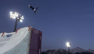 Ukraine's Oleksandr Abramenko jumps during men's freestyle skiing aerials training at the Rosa Khutor Extreme Park, at the 2014 Winter Olympics, Saturday, Feb. 15, 2014, in Krasnaya Polyana, Russia. (AP Photo/Andy Wong)