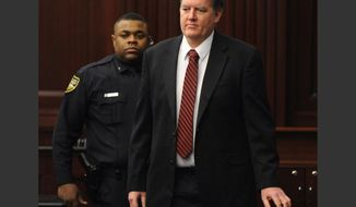 Defendant Michael Dunn is brought into the courtroom just before 5 p.m., where Judge Russell Healey announced that the jury was deadlocked on charge one and have verdicts on the other four charges as they deliberate in the trial of Dunn, Saturday, Feb. 15, 2014, for the shooting death of Jordan Davis in November 2012. Dunn is charged with fatally shooting 17-year-old Davis after an argument over loud music outside a Jacksonville convenient store. (AP Photo/The Florida Times-Union, Bob Mack, Pool)