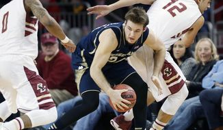 Boston College's Garland Owens (0) and Ryan Anderson (12) defend against Notre Dame's Pat Connaughton (24) in the first half of an NCAA college basketball game in Boston, Sunday, Feb. 16, 2014. (AP Photo/Michael Dwyer)