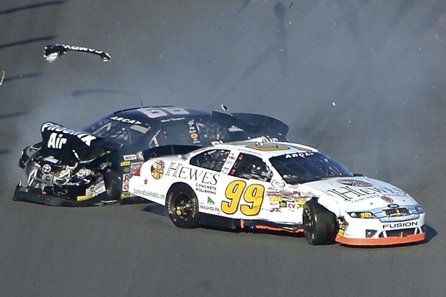 Mark Thompson (66) and Buster Graham (99) collide on the front stretch during the ARCA Series auto race at Daytona International Speedway in Daytona Beach, Fla., Saturday, Feb. 15, 2014. (AP Photo/Phelan M. Ebenhack)