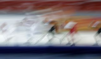 Sven Kramer of the Netherlands, center, practices at the Adler Arena Skating Center at the 2014 Winter Olympics, Friday, Feb. 14, 2014, in Sochi, Russia. (AP Photo/Matt Dunham)