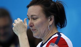 American Ann Swisshelm wipes away tears after losing to South Korea during women's curling competition against at the 2014 Winter Olympics, Monday, Feb. 17, 2014, in Sochi, Russia. (AP Photo/Robert F. Bukaty)