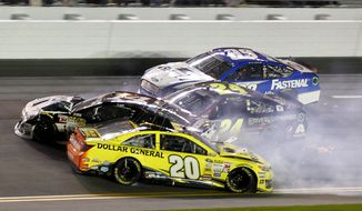 Matt Kenseth (20) slides backward as he is involved in a crash with Tony Stewart (14), Jeff Gordon (24) and Carl Edwards (99) on the front stretch during the NASCAR Sprint Unlimited auto race at Daytona International Speedway in Daytona Beach, Fla., Saturday, Feb. 15, 2014. (AP Photo/Terry Renna)