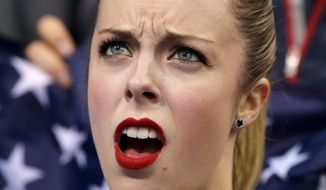 FILE PHOTO - In this Feb. 8, 2014 photo,  Ashley Wagner, of the United States, waits for her results after competing in the women's team short program figure skating competition at the Iceberg Skating Palace during the 2014 Winter Olympics, Saturday, Feb. 8, 2014, in Sochi, Russia. (AP Photo/Darron Cummings, Pool, File)