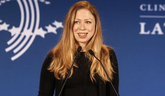 "FILE - In a Dec. 9, 2013, file photo Chelsea Clinton speaks during a CGI Clinton Global Initiative Latin America event at the Copacabana Palace in Rio de Janeiro, Brazil.  Clinton, in an address at a national conference Sunday Jan. 16, 2014, in Las Vegas, called lesbian, gay, bisexual and transgender issues ""the unfinished business of the 21st century."" (AP Photo/Silvia Izquierdo, file)"