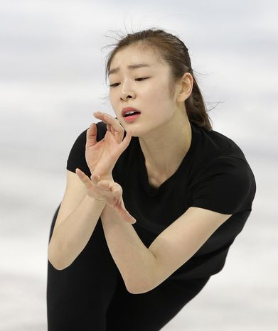 Yuna Kim of South Korea skates during a practice session at the Iceberg Skating Palace during the 2014 Winter Olympics, Sunday, Feb. 16, 2014, in Sochi, Russia. (AP Photo/Darron Cummings)