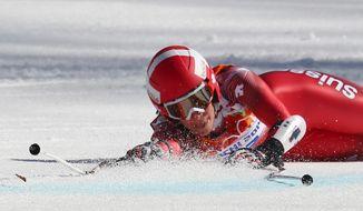 Switzerland's Dominique Gisin falls in the women's super-G at the Sochi 2014 Winter Olympics, Saturday, Feb. 15, 2014, in Krasnaya Polyana, Russia. (AP Photo/Alessandro Trovati)