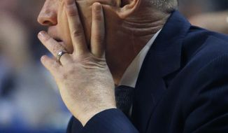 Penn State head coach Pat Chambers watches during the first half of an NCAA college basketball game against Iowa on Saturday, Feb. 15, 2014, in State College. Iowa won 82-70. (AP Photo/Keith Srakocic)