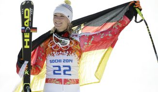 Germany's Maria Hoefl-Riesch poses for photographers on the podium after winning the silver medal in the women's super-G at the Sochi 2014 Winter Olympics, Saturday, Feb. 15, 2014, in Krasnaya Polyana, Russia. (AP Photo/Gero Breloer)