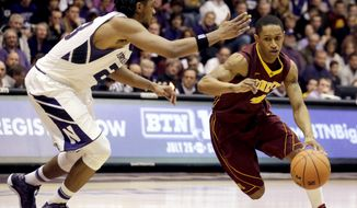 Minnesota guard DeAndre Mathieu, right, drives against Northwestern guard JerShon Cobb during the first half of an NCAA college basketball game in Evanston, Ill., Sunday, Feb. 16, 2014. (AP Photo/Nam Y. Huh)