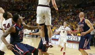 Arizona State's Jordan Bachynski (13) blocks the final shot by Arizona as Arizona players Rondae Hollis-Jefferson (23) and Kaleb Tarczewski (35) and Arizona State's Bo Barnes (4) all look on during the second overtime of an NCAA college basketball game, Friday, Feb. 14, 2014, in Tempe, Ariz.  Arizona State defeated Arizona 69-66 in double overtime. (AP Photo/Ross D. Franklin)