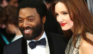 Actors Chiwetel Ejiofor and Sari Mercer pose for photographers on the red carpet at the EE British Academy Film Awards held at the Royal Opera House on Sunday Feb. 16, 2014, in London. (Photo by Joel Ryan/Invision/AP)