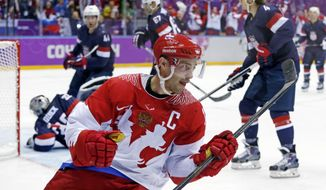 Russia forward Pavel Datsyuk reacts after scoring a goal against the USA in the second period of a men's ice hockey game at the 2014 Winter Olympics, Saturday, Feb. 15, 2014, in Sochi, Russia. (AP Photo/Julio Cortez)