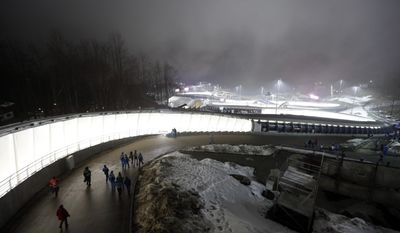Fog settles in the Sanki Sliding Center during the men's two-man bobsled competition at the 2014 Winter Olympics, Sunday, Feb. 16, 2014, in Krasnaya Polyana, Russia. (AP Photo/Natacha Pisarenko)
