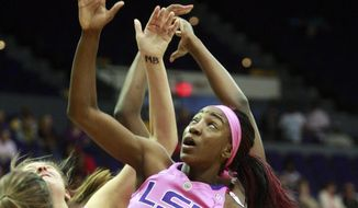 LSU guard Raigyne Moncrief (11) battles for a rebound against South Carolina in the first half of an NCAA college basketball game in Baton Rouge, La., Sunday, Feb. 16, 2014. (AP Photo/Tim Mueller)
