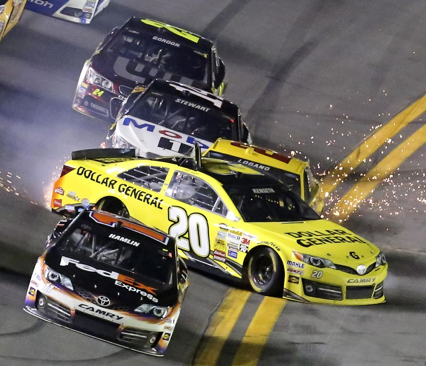 Matt Kenseth (20) slides sideways in front of Joey Logano (22), Tony Stewart (14) and Jeff Gordon (24), starting a multi-car crash in the front stretch during the NASCAR Sprint Unlimited auto race at Daytona International Speedway in Daytona Beach, Fla., Saturday, Feb. 15, 2014. Denny Hamlin, front, escaped the wreck. (AP Photo/David Graham)
