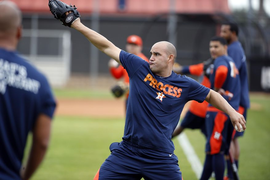 Houston Astros pitcher Raul Valdes throws during a spring training baseball workout, Saturday, Feb. 15, 2014, in Kissimmee, Fla. (AP Photo/Alex Brandon)