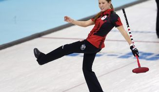 Canada's Kaitlyn Lawes reacts after a successful throw during women's curling competition against Japan at the 2014 Winter Olympics, Saturday, Feb. 15, 2014, in Sochi, Russia. (AP Photo/Robert F. Bukaty)