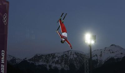 Switzerland's Christopher Lambert jumps during men's freestyle skiing aerials training at the Rosa Khutor Extreme Park, at the 2014 Winter Olympics, Saturday, Feb. 15, 2014, in Krasnaya Polyana, Russia. (AP Photo/Andy Wong)