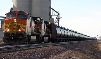 With potentially-explosive shipments increasing 40-fold in recent years as North American crude production booms, the railroad industry, at the urging of the Obama administration and safety officials in the U.S. and Canada, is considering a closer look at the risks posed by trains that now carry hazardous liquids through every region of the country. (AP Photo/Matthew Brown, File)