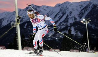 France's Martin Fourcade competes during the men's biathlon 20k individual race at the 2014 Winter Olympics, Thursday, Feb. 13, 2014, in Krasnaya Polyana, Russia. Fourcade won the gold medal. (AP Photo/Jae C. Hong)