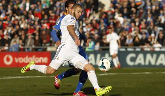 Real's Karim Benzema prepares to score his goal during a Spanish La Liga soccer match between Real Madrid and Getafe at the Coliseum Alfonso Perez stadium in Madrid, Spain, Sunday, Feb. 16, 2014. (AP Photo/Gabriel Pecot)