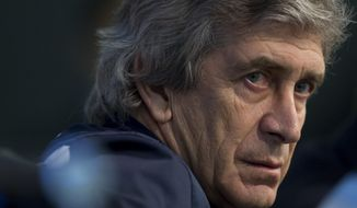 Manchester City manager Manuel Pellegrini waits to answer questions during a press conference at the Etihad Stadium, Manchester, England, Monday Feb. 17, 2014. Manchester City will play Barcelona on Tuesday in a Champions League first knock out round soccer match. (AP Photo/Jon Super)