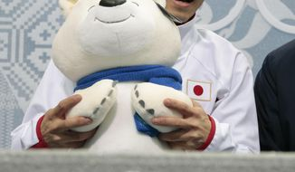 Daisuke Takahashi of Japan waits for his results after the men's free skate figure skating final at the Iceberg Skating Palace at the 2014 Winter Olympics, Friday, Feb. 14, 2014, in Sochi, Russia. (AP Photo/Ivan Sekretarev)