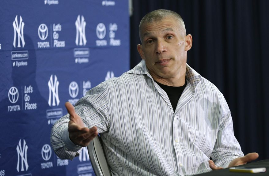 New York Yankees manager Joe Girardi speaks during a news conference following a spring training baseball practice Friday, Feb. 14, 2014, in Tampa, Fla. (AP Photo/Charlie Neibergall)